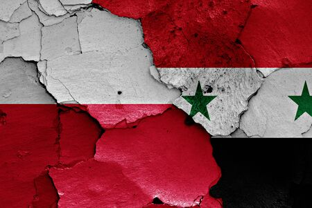 syrian civil war: flags of Poland and Syria painted on cracked wall