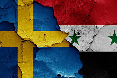 unwelcome: flags of Sweden and Syria painted on cracked wall