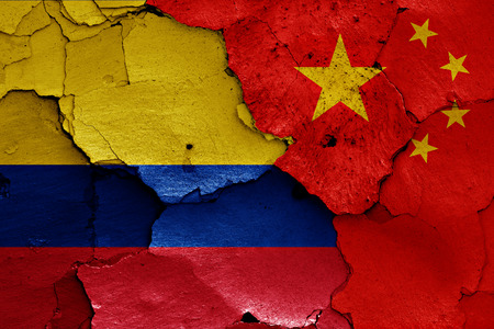colombian flag: flags of Colombia and China painted on cracked wall