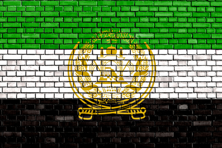 afghan flag: old flag of Afghanistan painted on brick wall