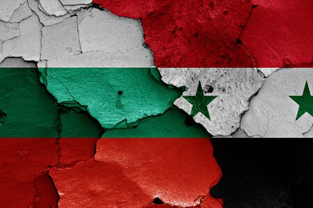 unwelcome: flags of Bulgaria and Syria painted on cracked wall Stock Photo