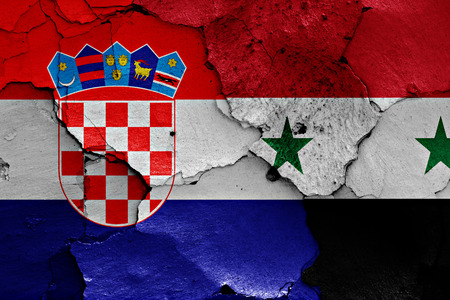 croatia flag: flags of Croatia and Syria painted on cracked wall