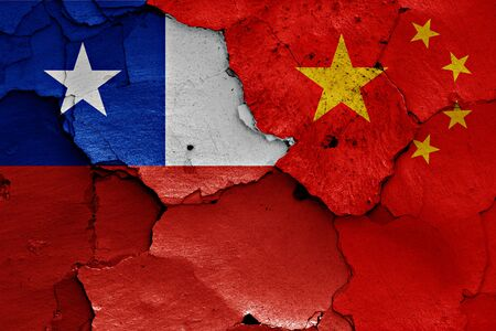 chile: flags of Chile and China painted on cracked wall