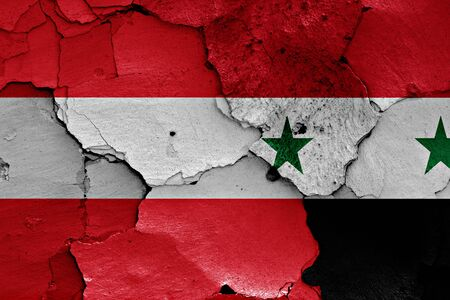 unwelcome: flags of Austria and Syria painted on cracked wall