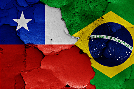 chile: flags of Chile and Brazil painted on cracked wall