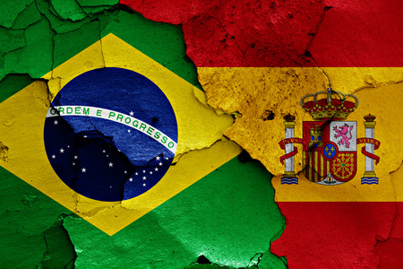 flag of spain: flags of Brazil and Spain painted on cracked wall Stock Photo