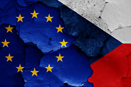 trade off: flags of EU and Czech republic painted on cracked wall