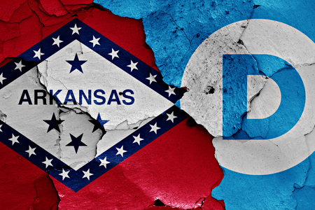 disintegrate: flag of Arkansas and Democrats painted on cracked wall