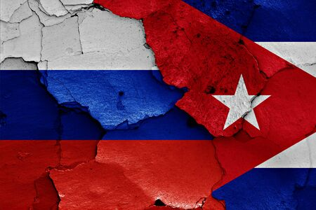russian flag: flags of Russia and Cuba painted on cracked wall