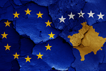 trade off: flags of EU and Kosovo painted on cracked wall