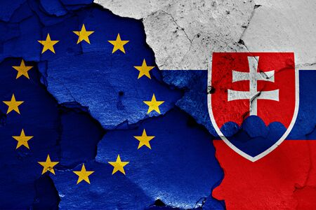 flags of EU and Slovakia painted on cracked wall