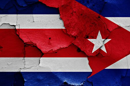 costa rican flag: flags of Costa Rica and Cuba painted on cracked wall