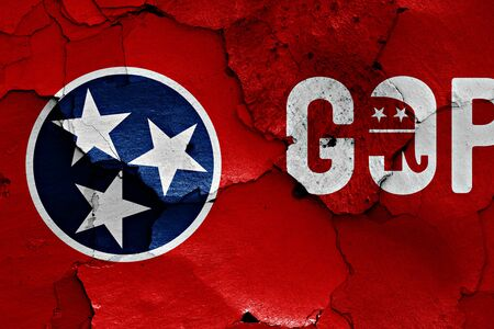 flag of Tennessee and GOP painted on cracked wall Stock Photo