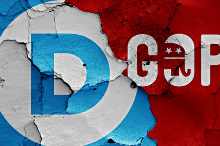 disintegrate: flag of Democrats and GOP painted on cracked wall