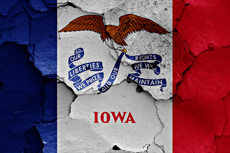 earthquake crack: flag of Iowa painted on cracked wall