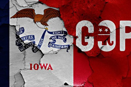 earthquake crack: flag of Iowa and gop painted on cracked wall