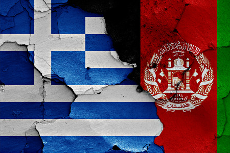 afghan flag: flags of Greece and Afghanistan painted on cracked wall Stock Photo