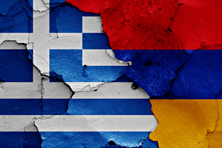 cracked wall: flags of Greece and Armenia painted on cracked wall