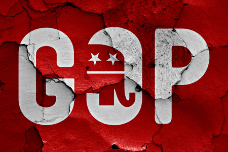 earthquake crack: flag of GOP painted on cracked wall