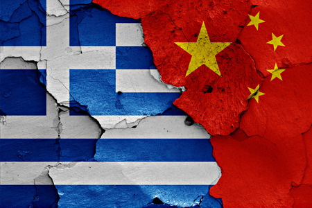 cracked wall: flags of Greece and China painted on cracked wall