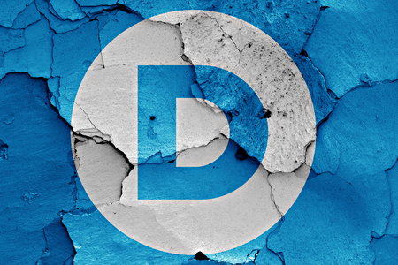 disintegrate: flag of Democrats painted on cracked wall