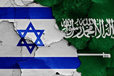 flag of israel: flags of Israel and Saudi Arabia painted on cracked wall