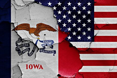 flags of Iowa and USA painted on cracked wall Imagens