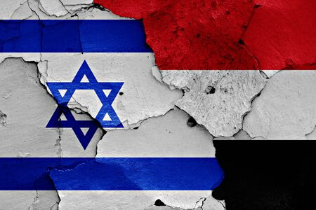 cracked wall: flags of Israel and Yemen painted on cracked wall