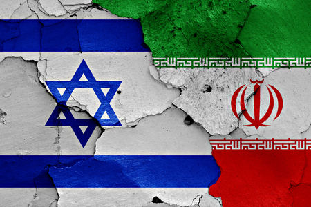 israel: flags of Israel and Iran painted on cracked wall Stock Photo