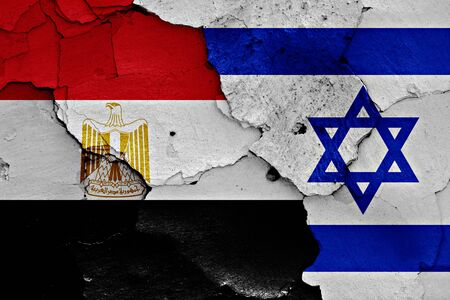 israeli flag: flags of Egypt and Israel painted on cracked wall
