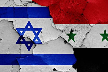 cracked wall: flags of Israel and Syria painted on cracked wall