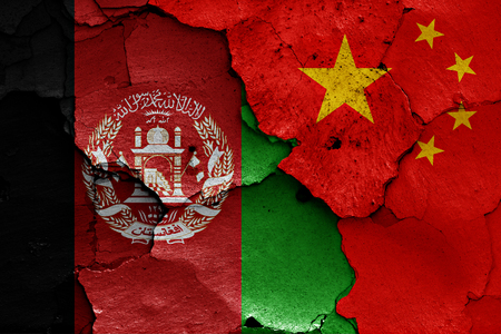 afghan flag: flags of Afghanistan and China painted on cracked wall