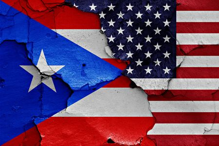 cracked wall: flags of Puerto Rico and USA painted on cracked wall Stock Photo