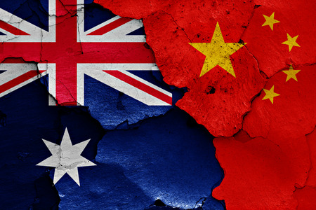 flags of Australia and China painted on cracked wall 版權商用圖片