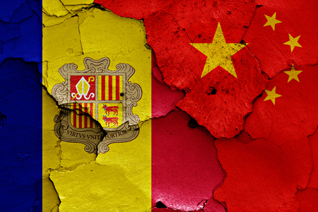 cracked wall: flags of Andorra and China painted on cracked wall