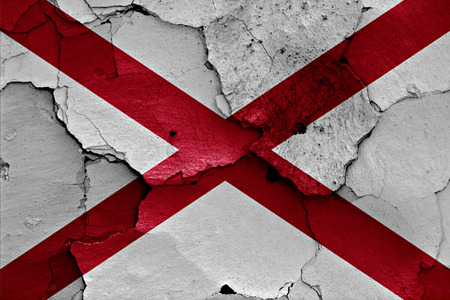 cracked wall: flag of Alabama painted on cracked wall Stock Photo