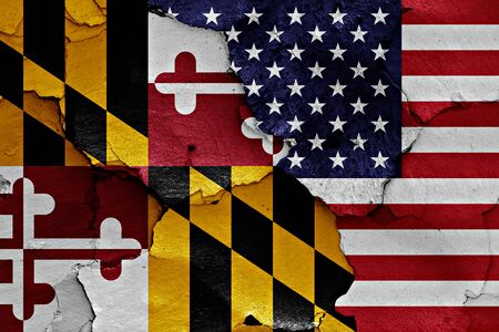 flags of Maryland and USA painted on cracked wall