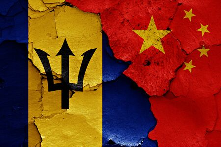 barbadian: flags of Barbados and China painted on cracked wall
