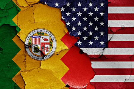 earthquake crack: flags of Los Angeles and USA painted on cracked wall