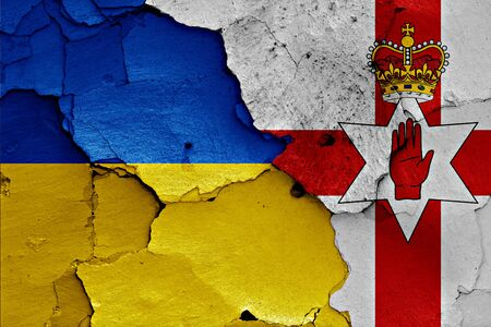 northern ireland: flags of Ukraine and Northern Ireland painted on cracked wall