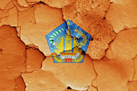 earthquake crack: flag of Bali painted on cracked wall Stock Photo