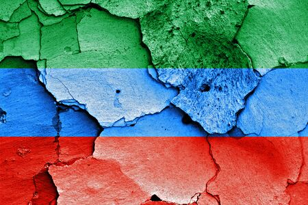 dagestan: flag of Dagestan painted on cracked wall