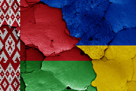 flags of Belarus and Ukraine painted on cracked wall