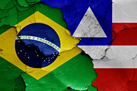 cracked wall: flags of Brazil and Bahia painted on cracked wall