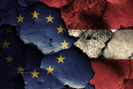 flags of EU and Austria painted on cracked wall Stock Photo