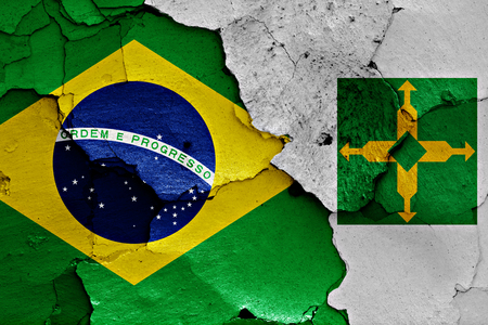 cracked wall: flags of Brazil and Brasilia painted on cracked wall Stock Photo
