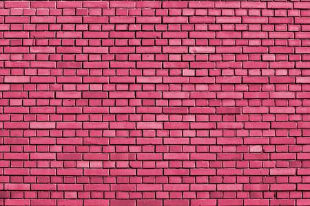 honeysuckle colored brick wall background Stock Photo