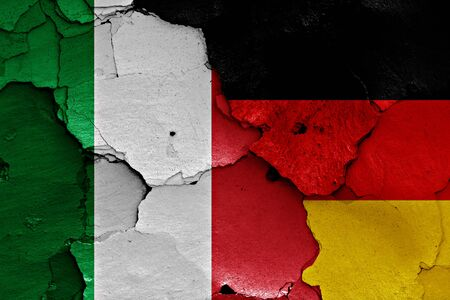 cracked wall: flags of Italy and Germany painted on cracked wall