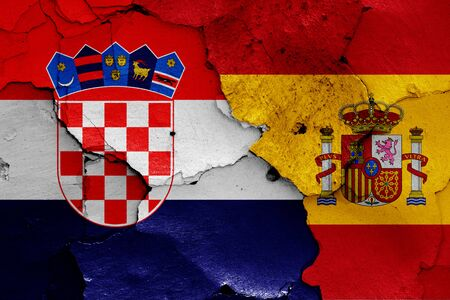 flags of Croatia and Spain painted on cracked wall