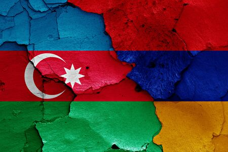 ceasefire: flags of Azerbaijan and Armenia painted on cracked wall